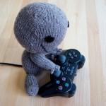 Sackboy spelar Playstation
