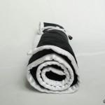 Stick- och virkfodral ihoprullat